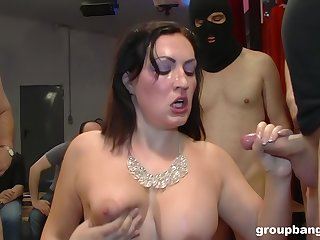 Mature pizzazz slut on her knees getting fucked during a gangbang