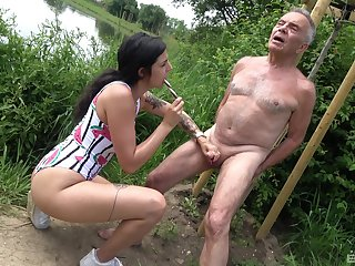 Provocative battle-axe drops on her knees to suck an older man's dick