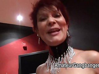 Mature redhead takes two together with regard to her pussy