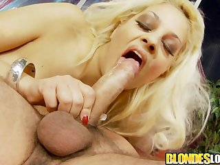 Sexy blonde girl Katie Kaliana gets kissed coupled with she gives a wonderful blowjob