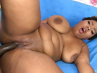 Chubby ebony woman loads her fat cunt less a unstinting BBC